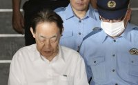 Ex-Japanese top official says he killed son to prevent attack on children