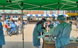 New cases fall below 700; cluster infections, travelers strain virus fight