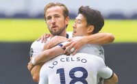 Kane double dents Leicester's Champions League bid