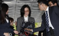 Wife of ex-justice minister arrested in corruption probe