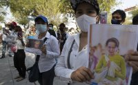 Myanmar's Suu Kyi charged, can be held until Feb. 15