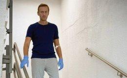 Kremlin critic Navalny posts photo of himself walking