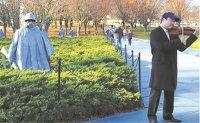 Violinist plays 'music of peace' at Korean War memorials