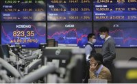 World markets rise as investors eye US election