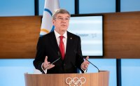 Re-elected Bach promises 'safe, secure' Tokyo Olympics