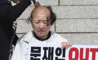 Another female lawmaker shaves head to protest new justice minister [PHOTOS]