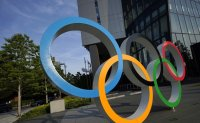 IOC seeks insurance compensation for delayed Olympics