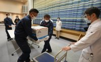Japan outlines cautious vaccine schedule ahead of first shots