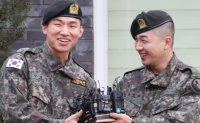 BIGBANG's Taeyang, Daesung discharged from military