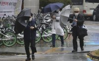 Seoul soaked by heaviest daily rainfall on record for November