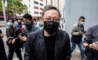 Hong Kong police charge dozens of dissidents with security crime