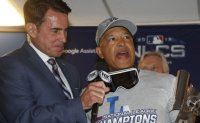 Beloved in Boston, Roberts returns for World Series with Dodgers