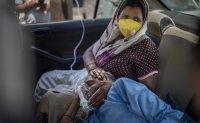 India coronavirus cases set new global record, US readies help