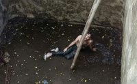 Tourist rescued after being trapped 6 days in well in Bali
