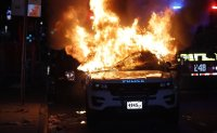 Police cars destroyed, windows smashed as protests roil New York