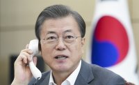 WHO chief requests Moon's role in global fight against coronavirus