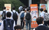 Students in greater Seoul return to school as virus slows