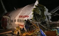 18 killed as Indian jet crashes at storm-hit airport