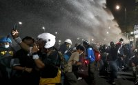 Thai police use water cannon to stop pro-democracy march to palace