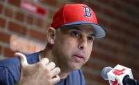 Red Sox stripped of pick, Cora banned in sign stealing scams