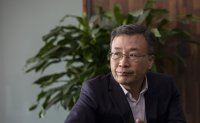 K bank chief's term extended again