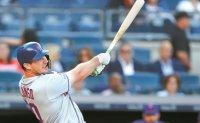 Alonso helps Mets gain split; Voit lifts Yanks in opener