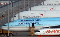 Korea Development Bank to inject W800 bil. for Korean Air's takeover of Asiana