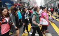 Hong Kong's 'sandwich generation' pressured by rising dependants