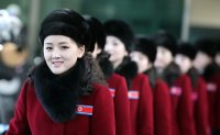 North Korean cheerleaders travel to South Korea ahead of Olympics