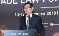 Justice minister pledges to expand class action lawsuit system