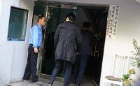 Justice minister's home searched over corruption scandal