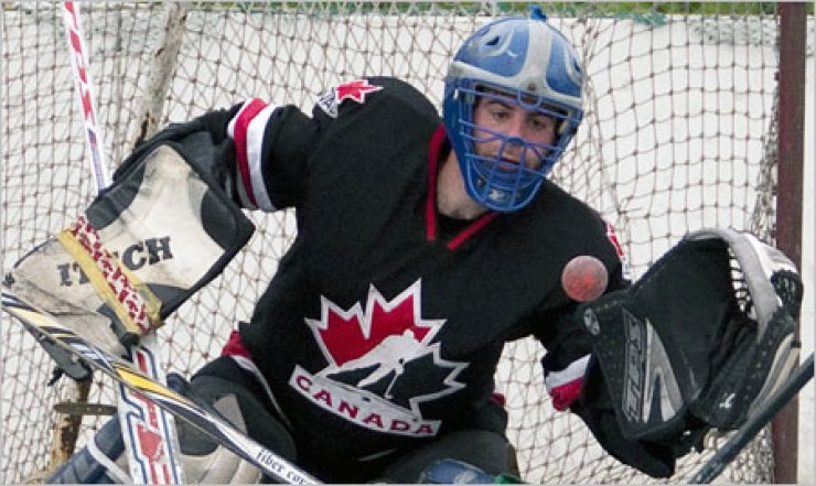 Chris Patenaude-Vaz makes a glove save in Canada Ball Hockey Korea action during the spring 2012 season at Jamsil Sports Complex.                                                                                                      / Photo by Andrei Cherwinski