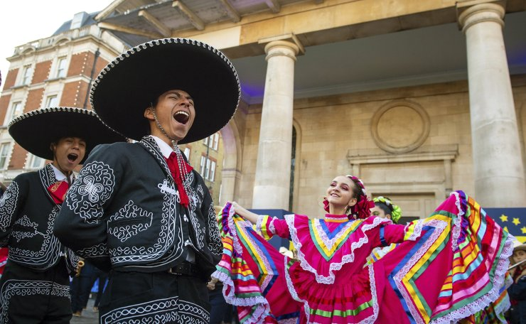 Members of Carnaval del Pueblo, a group of performers from Latin and South America, gesture during a preview of their London New Year's Day Parade show, at the Covent Garden Piazza in London, Monday, Dec. 30, 2019. AP