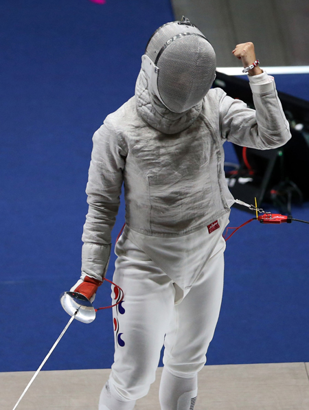 From topt are equestrian Hwang Young-shik, fencer Lee Ra-jin and wushu practitioner Lee Ha-sung, who won gold medals on the first day of the Incheon Asian Games, Saturday, pushing South Korea to the top of the medal rankings with five gold, five silver and three bronze. / Yonhap