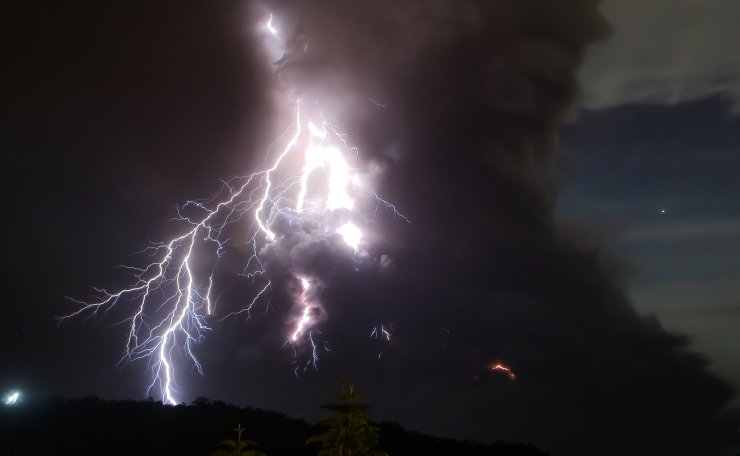 Lightning flashes as the Taal volcano erupts in Tagaytay, the Philippines, Jan. 12, 2020. The Philippines raised the alert level to 4 on a scale of 5 over the Taal volcano eruption on Sunday, saying that 'hazardous explosive eruption is possible within hours to days' as volcanic activity increased. Xinhua