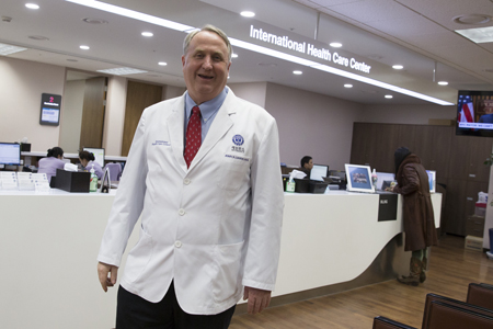 John Linton's friendly jovial face would instantly calm a patient, but his passion would also engage people in causes that better human rights. Linton poses during an interview with The Korea Times Tuesday at his office at Severance Hospital at Yonsei University, Sinchon, Seoul./ Korea Times photos by Choi Won-suk