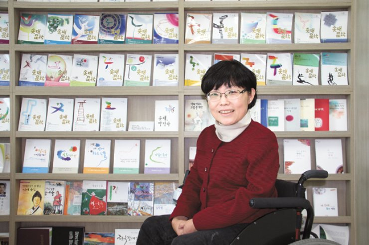 Bang Gui-hee, the founder and publisher of the literary quarterly Sotdae Literature, poses in her office in Seoul on Nov. 17 after an interview. / Korea Times