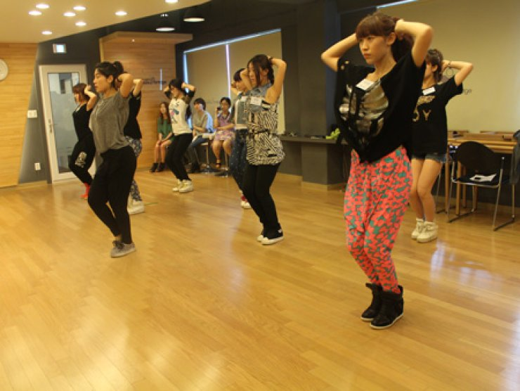 Chinese girl group Seven Sense practice dance moves during the first session of their six months-long training at Rainbowbridge Agency in Bangbae-dong, Seoul earlier this month. / Courtesy of Rainbowbridge Agency