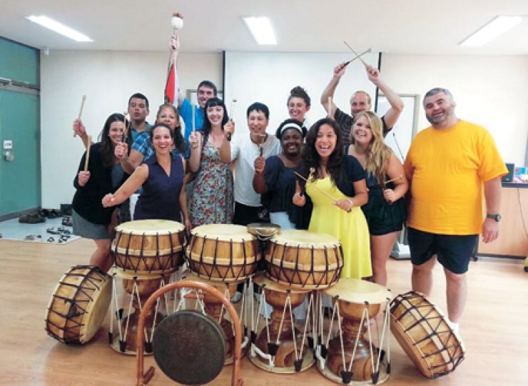 Participants in the Fulbright-Hays Group Projects Abroad (GPA) grant program pose during a two-hour class to learn how to play Korea's traditional instruments at the Institution of Korean Culture and Education,Kongju National University, Aug. 1. / Courtesy of Fulbright-Hays Group