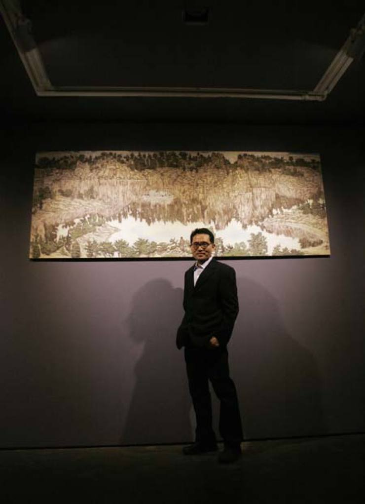 Artist Yoo Geun-taek poses in front of his painting 'Landscape' at OCIMuseum in central Seoul. / Courtesy of OCI Museum