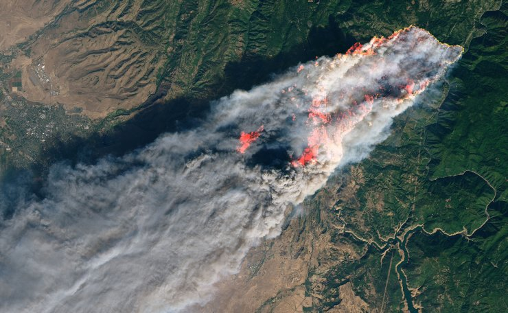 This NASA Earth Observatory handout image taken on November 8, 2018 and released on November 10, 2018 shows the Camp Fire burning in Paradise, California. AFP
