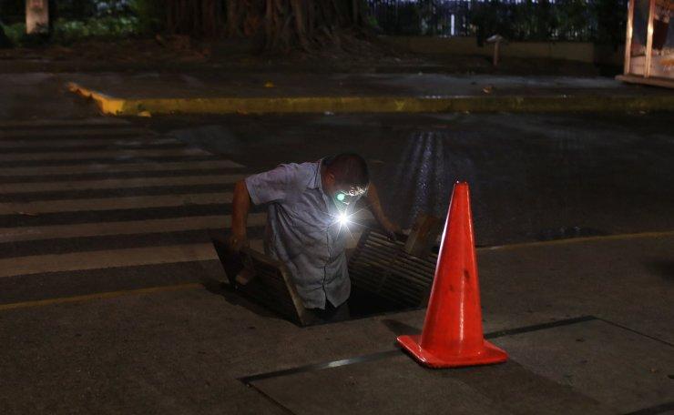 A Corpoelec worker prepares to check a line in Caracas, Venezuela March 11, 2019. Reuters
