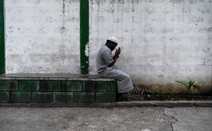 A Muslim man offer prayers prior iftar, the meal after sunset, at the Masjid At-Tawheed mosque on the first day of the Muslim holy month of Ramadan in Port-au-Prince on May 6, 2019. AFP