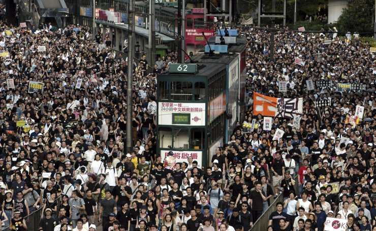 In this July 1, 2003 file photo, tens of thousands of people pack a Hong Kong street while marching to Hong Kong government headquarters to protest the Hong Kong government's plans to enact an anti-subversion bill that critics fear will curtail civil liberties. AP