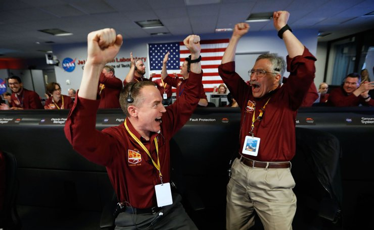NASA engineers on the flight team, Kris Bruvold (L) and Sandy Krasner (R) celebrate the InSight spacecraft's successfull landing on the planet Mars from the Mission Support area in the Space Flight Operations facility at the NASA Jet Propulsion Laboratory (JPL) in Pasadena, California on November 26, 2018. Cheers and applause erupted at NASA's Jet Propulsion Laboratory as a $993 million unmanned lander, called InSight, touched down on the Red Planet and managed to send back its first picture. AFP