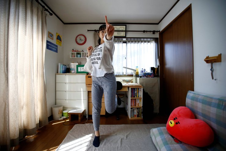 Nao Niitsu, 19, a college freshman from Tokyo, who wants to be a K-pop star, practices dancing to K-pop songs in her room in Tokyo, Japan, March 20, 2019. Reuters
