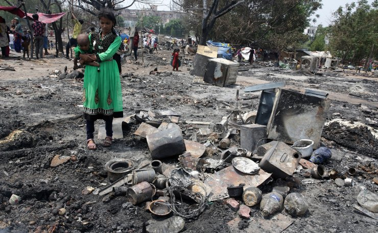 A Rohingya Refugees woman stand near damaged shanties after a fire damaged shanties at Maratha Basti near Tirkuta Nagar in Jammu, the winter capital of Kashmir, India, 03 June 2019. According to the local media, , a fire gutted around 150 shanties including 40 of those belonging to Rohingya Refugees at Maratha Basti near Tirkuta Nagar area and 500 families rendered homeless. No casualties were reported. EPA