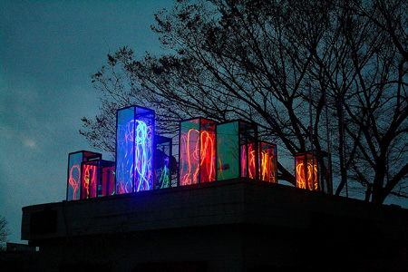 Artist Jin Si-yon stands with his light installation 'Flow' at E-Land Space in Seoul on May 14. / Korea Times photo by Shim Hyun-chul