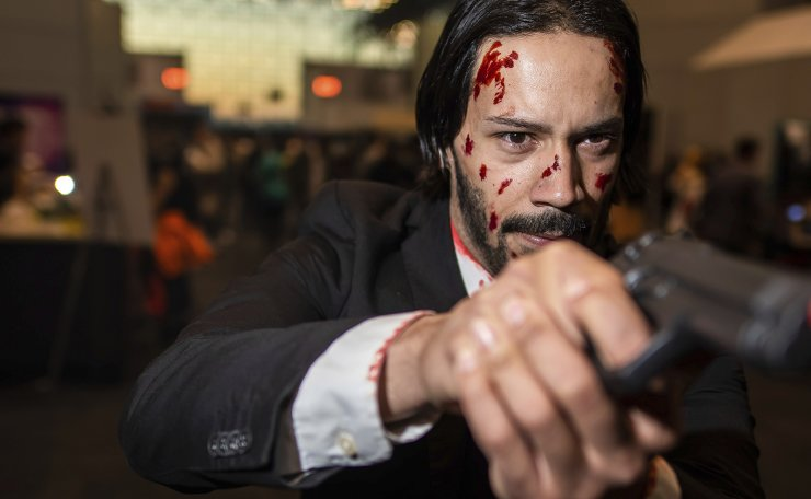 An attendee dressed as John Wick poses during New York Comic Con at the Jacob K. Javits Convention Center on Saturday, Oct. 5, 2019, in New York. AP
