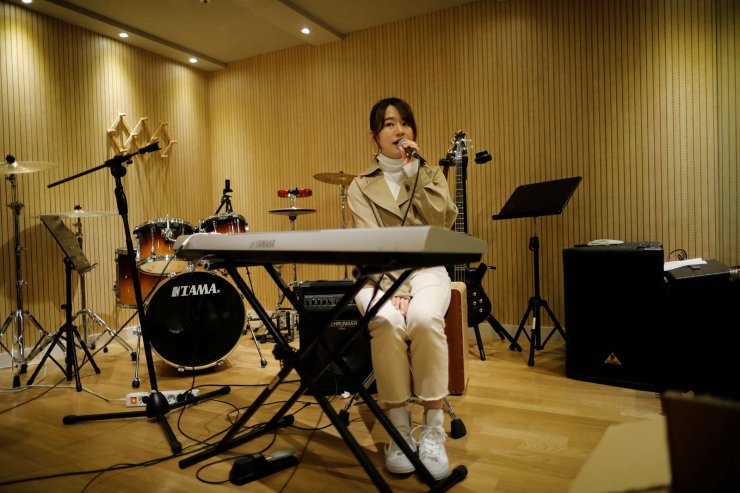 Japanese Miyu Takeuchi, a trainee with the K-pop agency Mystic Entertainment, sings during a training session in Seoul, South Korea, March 22, 2019. Takeuchi said it wasn't a difficult decision to leave a 10-year career with a top idol band AKB48 back home in Japan to sign with the K-pop agency Mystic Entertainment in March as a trainee. Even with her experience, she has seven hours of vocal training a day and two-hour dance lessons twice a week, plus early morning Korean lessons. She is not allowed to have a boyfriend but she says she has no regrets, despite the fact there is no guarantee she will make it. 'I don't know how long my training period will be, but it has to reach a point where my coaches and management company say 'Miyu, you are a professional!'' Reuters